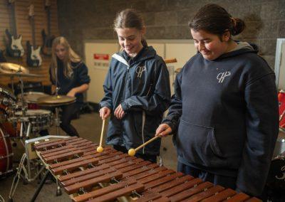Two female students playing the marimba